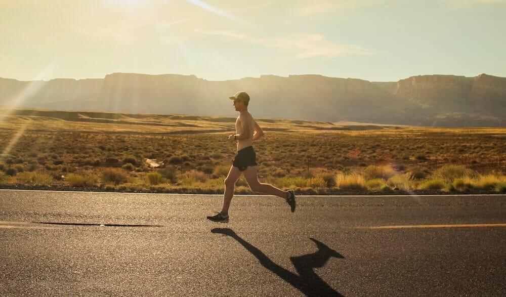 Road running at sunset